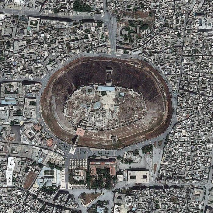 "Aleppo Citadel, a medieval fortified palace in Syria. If you rotate the image 180 degrees, the ""hole"" becomes a ""hill"" being an interesting optical illusion (26 May 2013)"