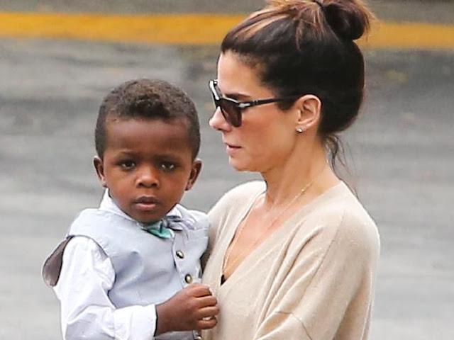 Doting mum ... Sandra Bullock picks up her little man Louis Bardo. Picture: SplashSource:Splash News Australia