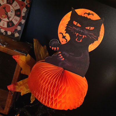 Black cat up a black glitter tree - a vintage-style paper decoration for Halloween 2015.