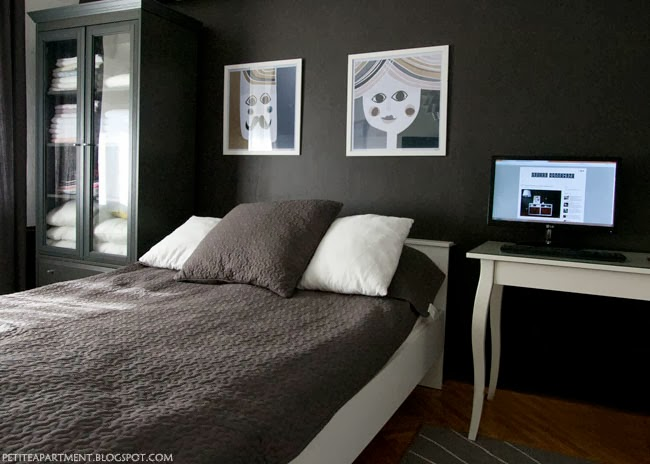 bedroom with black dark grey walls and white and grey ikea furniture