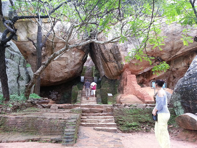 Sigiriya Boulder Terraced Gardens Entry begin behind giant boulders, which form narrow passage-arc to the foot of rock plateau.