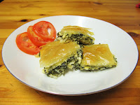 serve the greek spinach pie - spanakopita