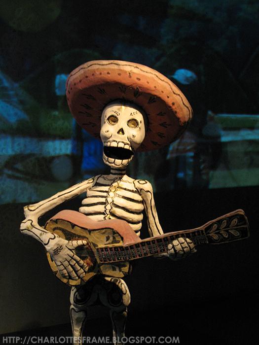 mayan skeleton playing guitar