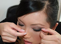 women apply false eyelashes