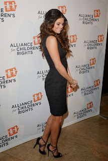 Selena Gomez Pictures in Black Dress at Alliance for Childrens Right Dinner