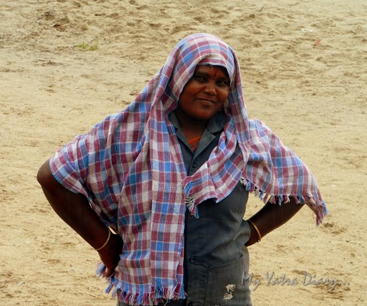 A sweeper posing at the Rameshwaram sea, Agni Teertham