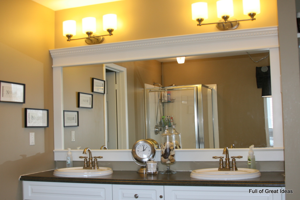 Full of great ideas how to upgrade your builder grade mirror frame it for How to frame mirror in bathroom