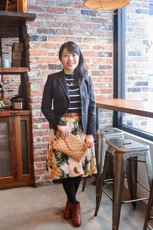 A casual coffee date outfit: black blazer, floral skirt, sailor stripes, and touches of cognac leather.