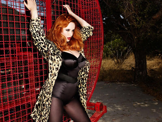 Christina Hendricks pin up holding on to red fence