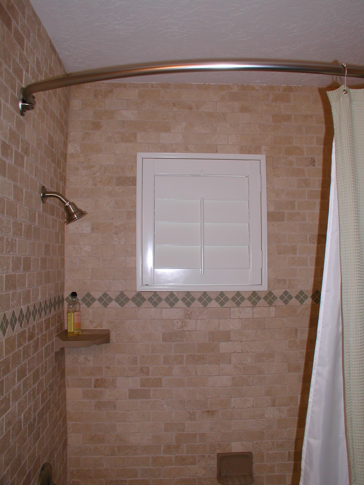 shower windows and vinyl shutters give full privacy and water proof