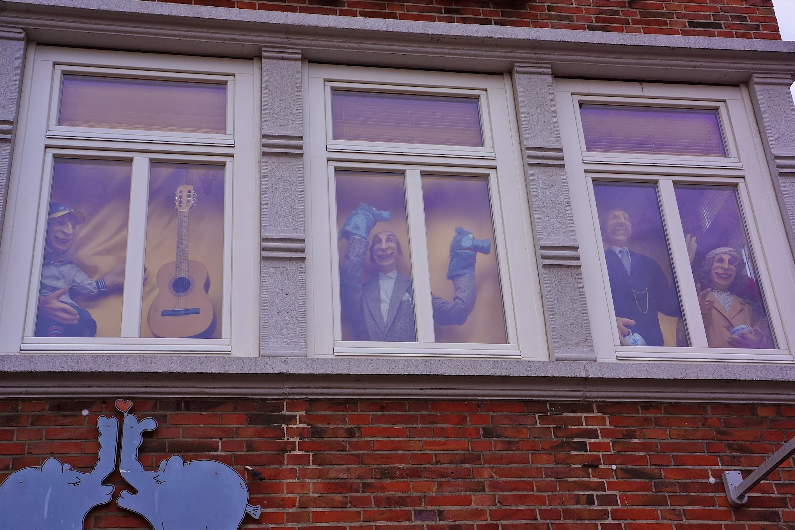 Picture of funny puppets in the windows of Dat Otto Huus in Emden, Germany.
