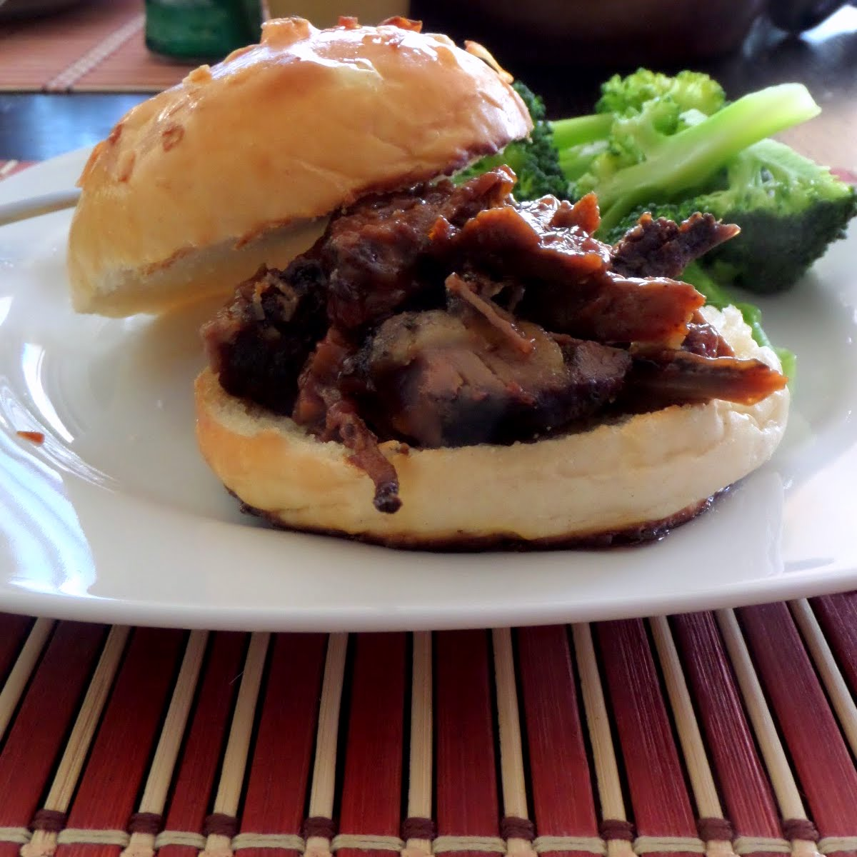 Barbecue Brisket Sandwiches:  Tender smoked brisket and barbecue sauce on a soft onion bun.
