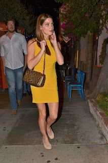 Ashley Greene looks cute in a yellow dress