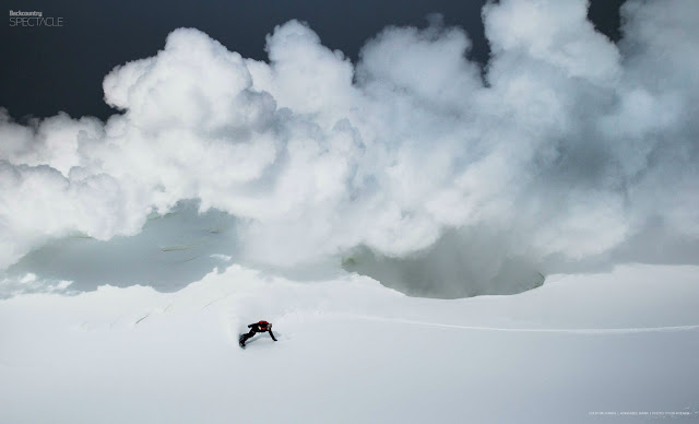 Colby Richards makes a turn with his snowboard below a sulfur cloud in Hokkaido Japan.