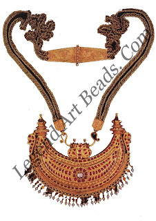 KOKKE THATHI (necklace) Karnataka. Coorg; 18th century Pendant H: 10 cm W: 10 cm Private collection the crescent moon shaped gold pendant set with cabuchon rubies and worked in fine relief on the reverse is surmounted by a cobra head; the ornament is part of the marriage jewels worn by Corgi brides
