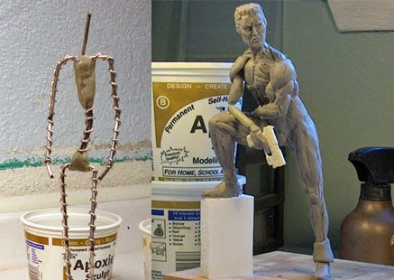 Wire armature beside clay model