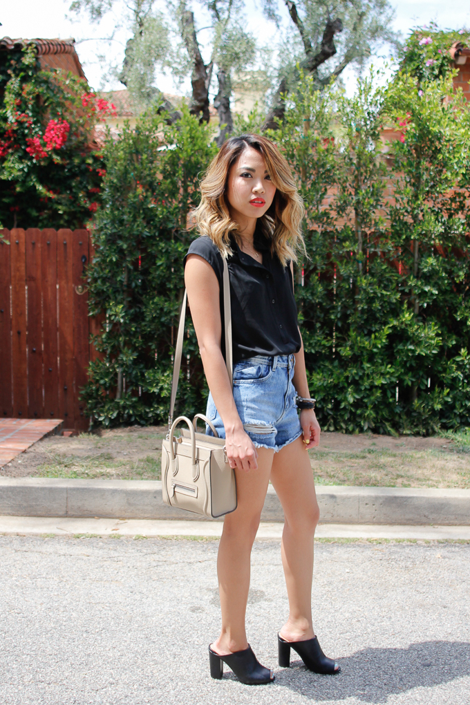 Ro & De black woven top, Zara high-waisted denim shorts, JustFab Lynne mules, Celine Nano bag, beautybitten