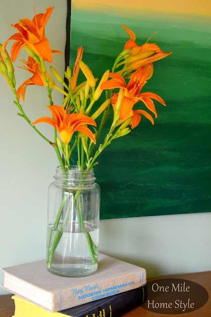 Orange Lilies, Vintage Books and Abstract Painting - One Mile Home Style