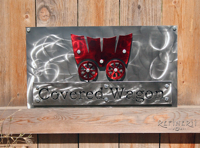 custom covered wagon sign