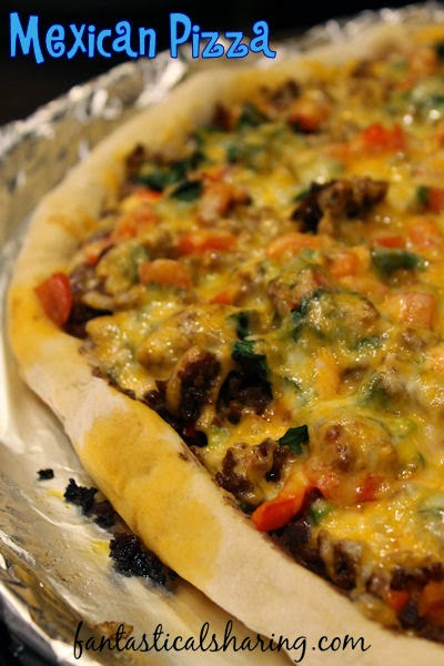 Mexican Pizza | This pizza boasts chorizo sausage, a black bean spread, cilantro, spicy jalapenos, and more! #recipe #pizza #SecretRecipeClub