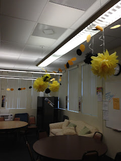pom poms hanging with garland