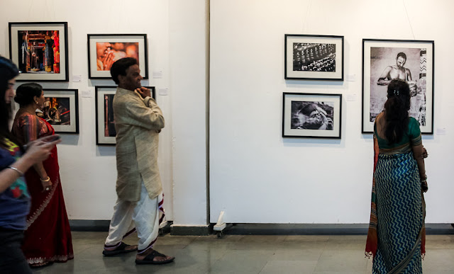 FAITHfully Yours show is going great and we are getting great response from art lovers. Many of the celebrities and national personalities are visiting the gallery & sharing their perspectives about the work being showcased. On Sunday evening, Raja & Radha reddy visited the gallery and it was amazing to see their interest in Photography Art. Let's check out this Photo Journey to know more about the famous Kuchipudi dancers of the country and how they responded to the show.Raja and Radha Reddy are a dancing couple who are renowned as exponents of the South Indian dance form of Kuchipudi. They founded and run the Natya Tarangini Institute of Kuchipudi Dance in. The duo are credited with having given Kuchipudi a new dimension without compromising on its traditional virtues and having taken it to a higher plane of performance. For their services to the field of arts, the Government of India have conferred on them the Padma Shri and Padma Bhushan awards.They walked through all the work-works being shown at Arpana Caur Gallery of Fine Arts. Mr. Raja Reddy seemed quite enthusiastic about Photographs and the theme Faith. He talked to each photographer about almost every photograph at the show and shared his opinions.