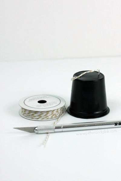 Use twine to create a hook for a snowman hat ornament.  pitterandglink.com
