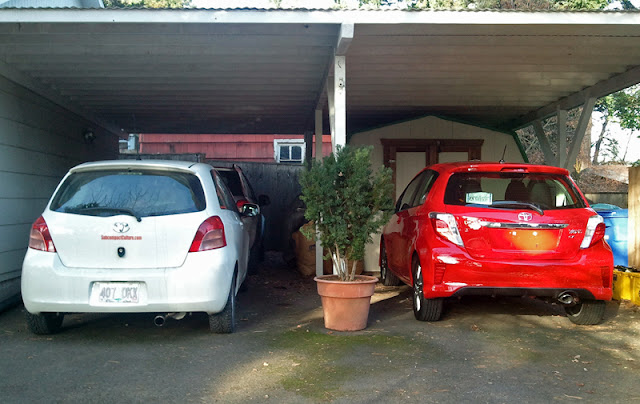 2007 Toyota Yaris hatchback next to the 2012 Toyota Yaris SE hatchback - Subcompact Culture