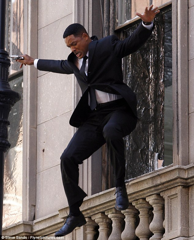 Action man! Will Smith throws himself out of a window as he does his own death-defying stunts filming Men In Black III
