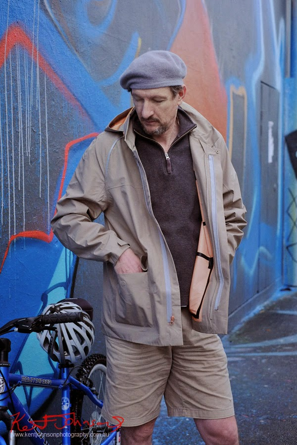 Portrait against grafitti wall; mountain bike, menswear fashion Levi's Modular Commuter Parka - Street Fashion Sydney.
