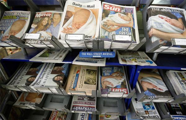 AKHBAR Britain memuatkan berita kelahiran bayi itu pada muka depan masing-masing.