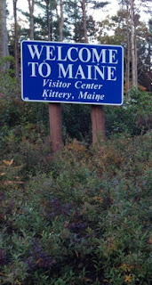 Welcome to Maine road sign