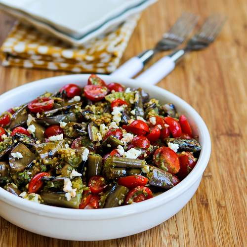 Grilled Eggplant and Grape Tomato Salad with Feta andEven Basil, Parsley, and Caper Sauce