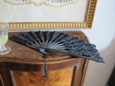 fan displayed on walnut cabinet in hotel in Venice