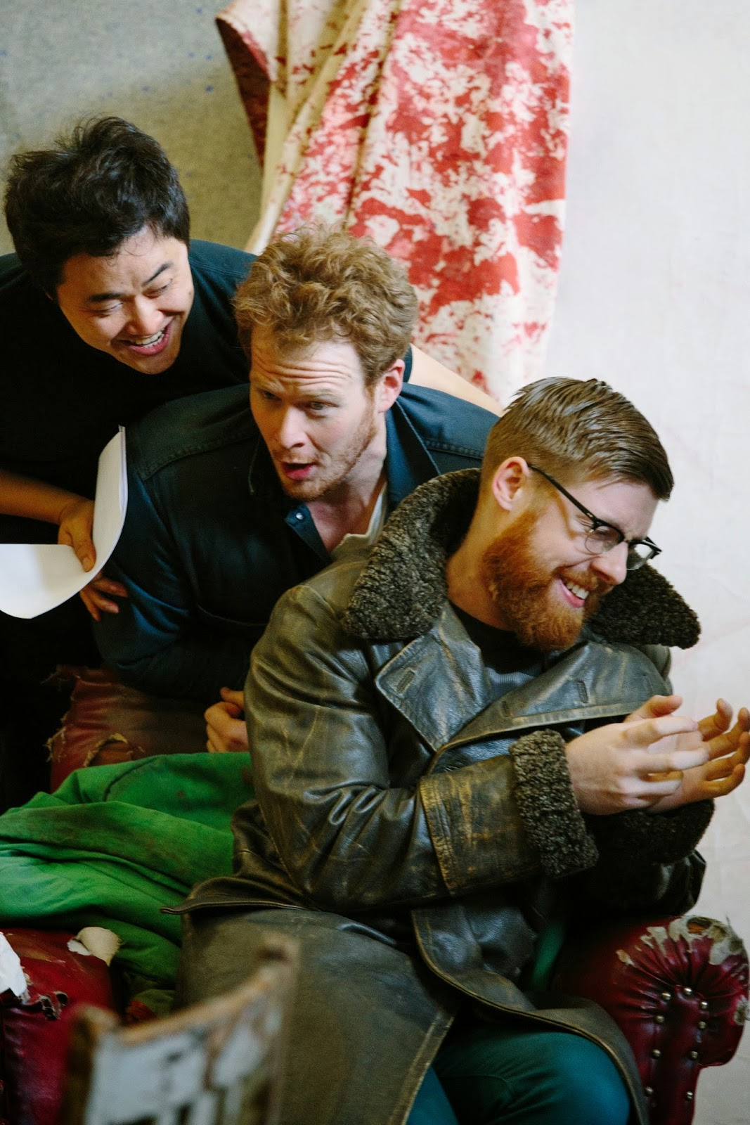 Duncan Rock (Marcello), Ji-Min Park (Rodolfo) and Barnaby Rea (Colline) in studio rehearsals for La Boheme in Leeds.Photo credit: Tom Arber