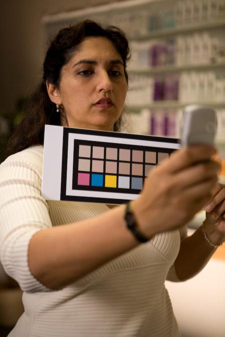 Dr. Nina Batthi holding special color chart