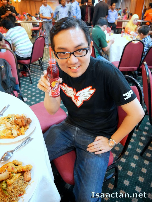 Just a candid moment, posing with one of Pran's product, the Sundrop Pomegranate drink