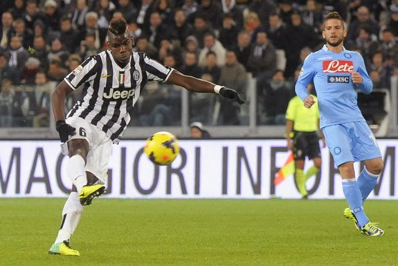 Juventus player Paul Pogba shoots to score his team's third goal against Napoli