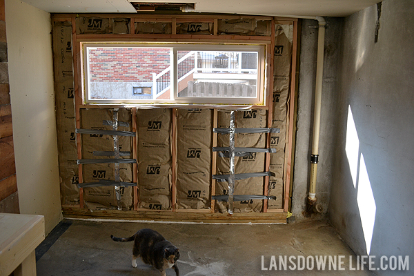 Replacing an old garage door with a wall lansdowne life for Convert two door garage into one
