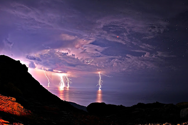 Total Lunar Eclipse and Lightning  Icaria, Greece June 15, 2011  Image Credit & Copyright: Chris Kotsiopoulos