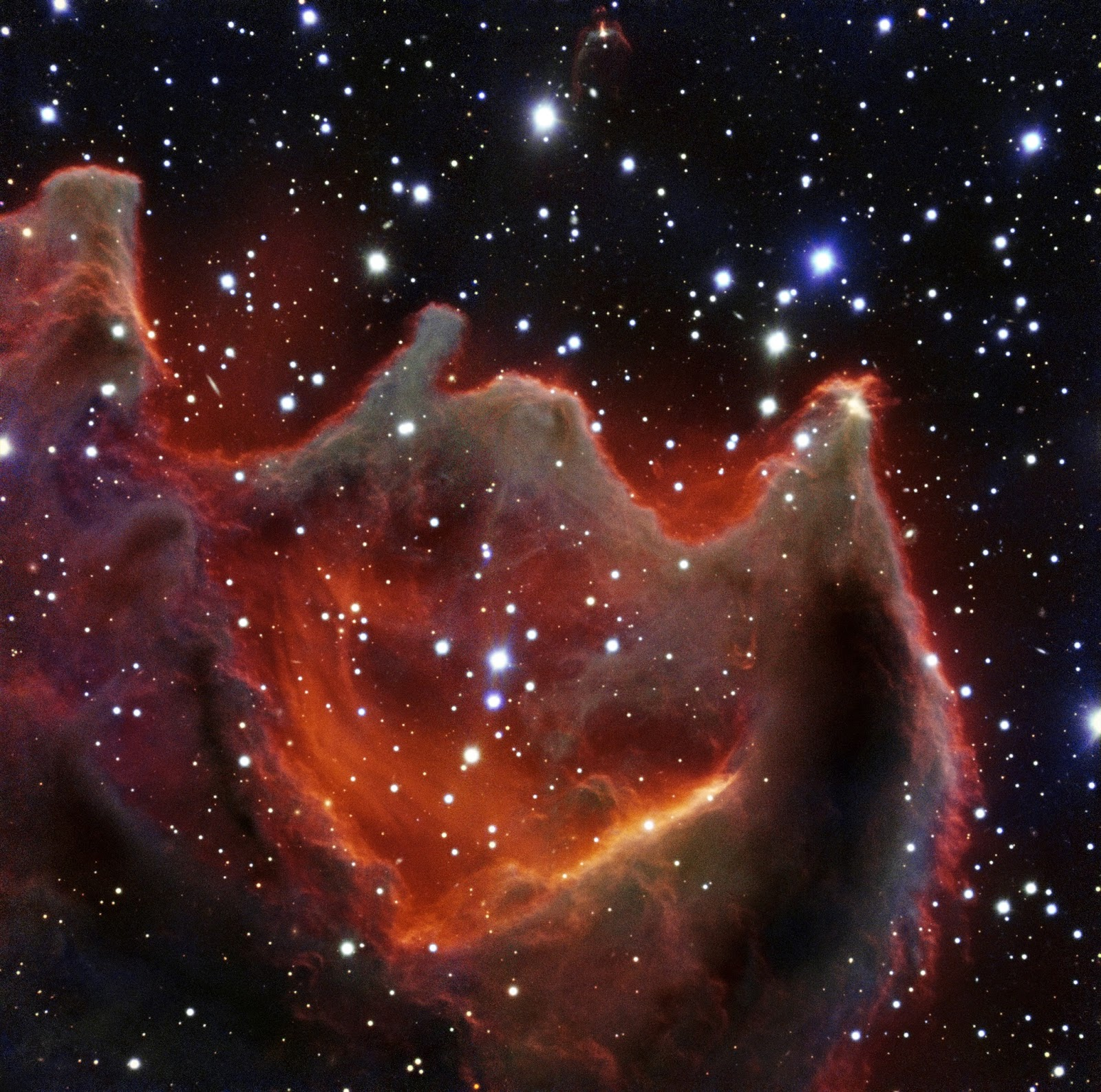 VLT image of the cometary globule CG4  VLT image of the cometary globule CG4   Like the gaping mouth of a gigantic celestial creature, the cometary globule CG4 glows menacingly in this image from ESO's Very Large Telescope. Although it looks huge and bright in this image it is actually a faint nebula and not easy to observe. The exact nature of CG4 remains a mystery.  Image Credit: ESO Explanation from: http://www.eso.org/public/images/eso1503a/