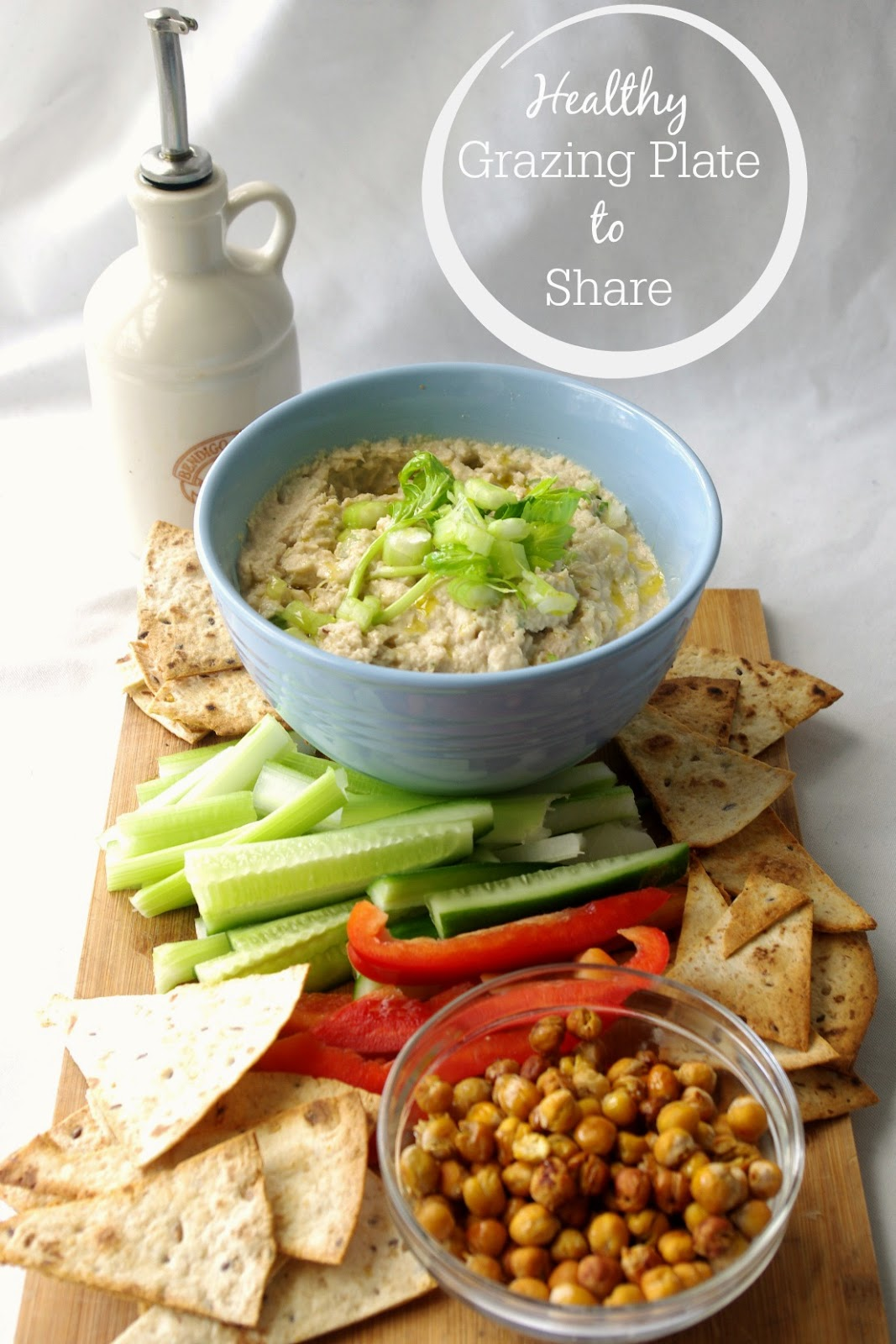 Healthy Grazing Plate to Share with dip, tortilla chips, chickpeas and crudites