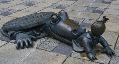 a crocodile coming out of a manhole and eating a capitalist