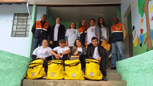 Foto Nudec Providência: Agentes voluntários do NUDEC de Providência, o 27º do município, com uniforme e equipamentos