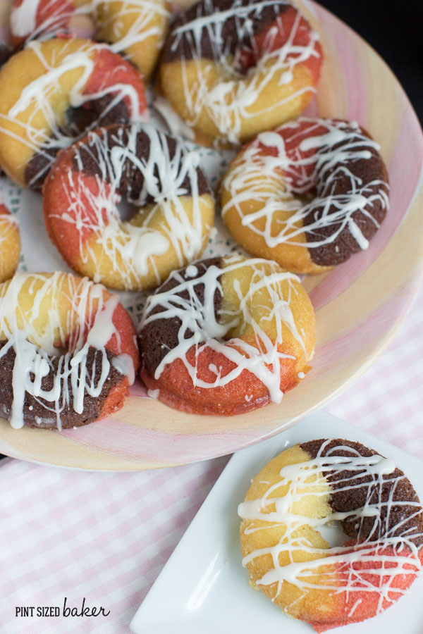 Looking for something different for a birthday cake? Try fun Neapolitan Cake Doughnuts! We loved these and they were so pretty and delicious!