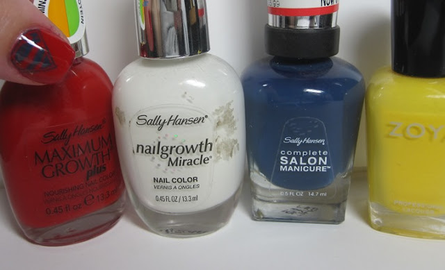 bottle shot:  Sally Hansen Sacred Scarlet, Sally Hansen White Tip, Sally Hansen Salon Blue Rose, and Zoya Pippa.
