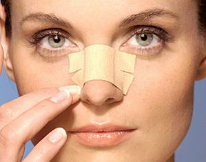 Bandages on nose after rhinoplasty or nose job