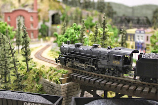 USRA Light Mikado 2-8-2 about to descend from the trestle