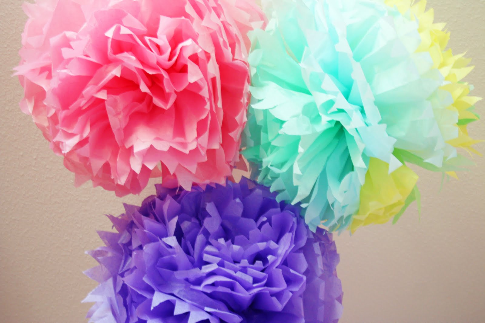 paper tissue pom poms I get two questions all the time and although its mentioned in the video: the paper used is tissue paper and it's 10-20 layers (your preference) works best w.