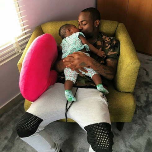 Davido cuddles daughter in new adorable photo...
